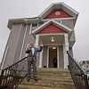 JAY YOUNG | THE GOSHEN NEWS<br /> LaCasa CEO Larry Gautsche stands on the front steps of 408 E. Lincoln Ave. in Goshen during a ribbon cutting event Thursday afternoon. LaCasa recently finished renovating the property. The house contains five apartmentss and the first tenants are expected the second week of April.