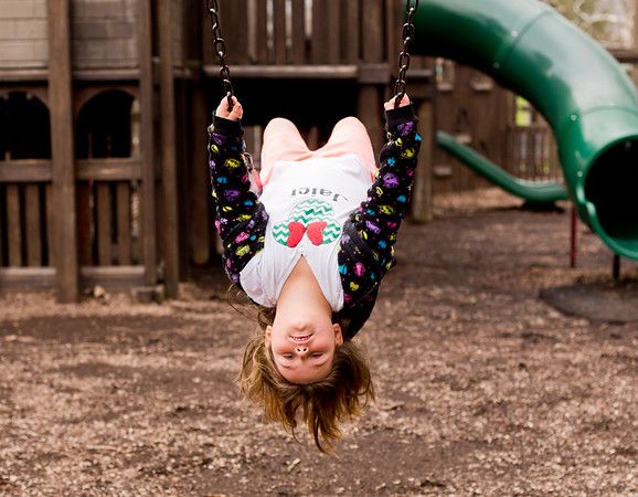 JAY YOUNG | THE GOSHEN NEWS<br /> Eight-year-old Jaici Mast, of Goshen, leans backwards to see the world upside-down as she swings high at Shanklin Park on Monday afternoon. Monday saw mild temperatures and scattered light rain. The National Weather Service forecasts mild temperatures for the rest of the week, which chances of rain towards the end of the week.