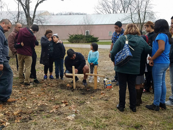 PHOTO CONTRIBUTED BY DELIA VASQUEZ<br /> Family and community join together Sunday afternoon to remember Susana Alvarez and Alberto Avelino, who were found dead in a van at a vacant lot along Edgewood Street in Elkhart Saturday. The coroner has determined the two died from single gunshot wounds to the head.