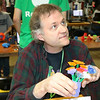 SHERRY VAN ARSDALL | THE GOSHEN NEWS Mark Peters, Kalamazoo, explains how he made flowers using a 3D printer during the Midwest RepRap Festival at the Elkhart County Fairgrounds Saturday.
