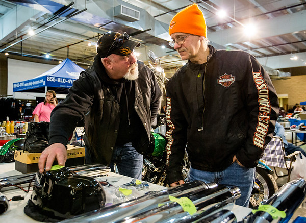 JAY YOUNG | THE GOSHEN NEWS<br /> Joe Hetherington, left, of Mishawaka and Dave Zimmerman, of Warsaw, look through a table of parts at the Abate of Indiana's 32nd annual Region One Elkhart County Swap Meet on Sunday morning at the Northern Indiana Event Center in Elkhart.