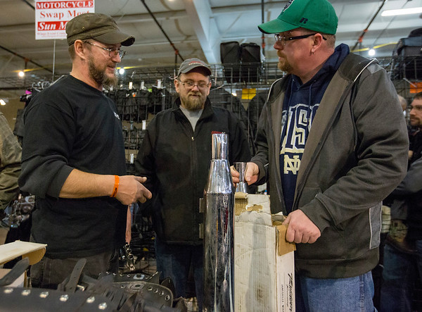 JAY YOUNG | THE GOSHEN NEWS<br /> From left, Joe Colassaco, Donnie Roberts and Scott Smith, all of Elkhart, discuss motorcycle parts at the Abate of Indiana's 32nd annual Region One Elkhart County Swap Meet on Sunday morning at the Northern Indiana Event Center in Elkhart.