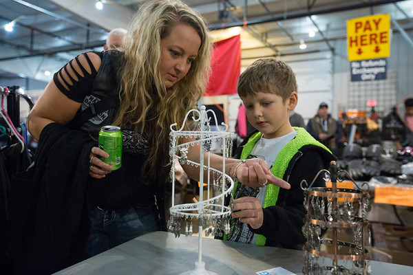 JAY YOUNG | THE GOSHEN NEWS<br /> Nichole DePriest looks through earrings with her son, seven-year-old Barrett, at the Abate of Indiana's 32nd annual Region One Elkhart County Swap Meet on Sunday morning at the Northern Indiana Event Center in Elkhart.
