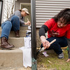 JAY YOUNG | THE GOSHEN NEWS<br /> Grand Valley State students Samantha DeGood, right, and Ashley Benedict paint an outside railing at a multi-ifamily property at 408 E. Lincoln Ave. in Goshen Monday morning. Frank is with a group of students from Grand Valley State University and Lewis University who are donating their spring break to volunteer with LaCasa to help restore the home. The house is part of LaCasa's East Lincoln Corridor Revitalization project. It is the first of five dilapidated multi-family dwellings that LaCasa is working to restore as part of the project.