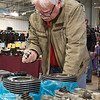 JAY YOUNG | THE GOSHEN NEWS<br /> Harlow Hawthorn, of Ontario, Canada, inspects a motorcycle part at the Abate of Indiana's 32nd annual Region One Elkhart County Swap Meet on Sunday morning at the Northern Indiana Event Center in Elkhart.