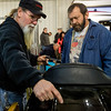JAY YOUNG | THE GOSHEN NEWS<br /> Vendor Homer Atkinson, of Bern, left, shows off a touring cycle trunk to Ed Reeves, of Edwardsburg, Michigan, at the Abate of Indiana's 32nd annual Region One Elkhart County Swap Meet on Sunday morning at the Northern Indiana Event Center in Elkhart.