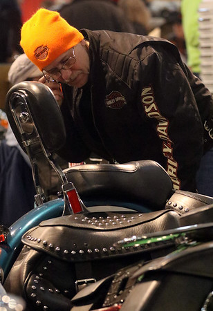 JAY YOUNG | THE GOSHEN NEWS<br /> Dave Zimmerman, of Warsaw, inspects a custom built Harley-Davidson motorcycle at the Abate of Indiana's 32nd annual Region One Elkhart County Swap Meet on Sunday morning at the Northern Indiana Event Center in Elkhart.