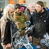 JAY YOUNG | THE GOSHEN NEWS<br /> From left, Eddie Davis, Zach Davis and Chris Faunce check out custom built Harley-Davidson motorcycles at the Abate of Indiana's 32nd annual Region One Elkhart County Swap Meet on Sunday morning at the Northern Indiana Event Center in Elkhart.