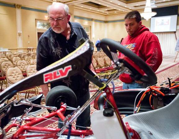 JAY YOUNG | THE GOSHEN NEWS<br /> Jim Mikel, left, and Terry Price look over a go-kart on display at the Lerner Theater on Monday evening in the Crystal Ballroom. After a 22 year hiatus, the Elkhart Grand Prix is returning in August as the Elkhart Riverwalk Grand Prix.