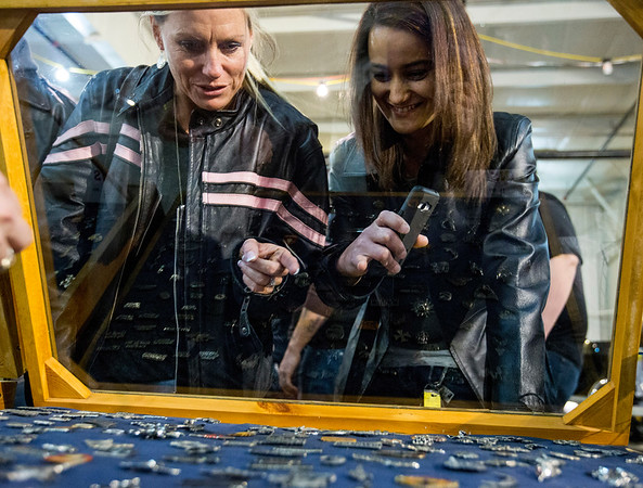 JAY YOUNG | THE GOSHEN NEWS<br /> Stefanie Holbrook, left, of Warsaw, and Roshonda Wagner, of Elkhart, look through a case of pins at the Abate of Indiana's 32nd annual Region One Elkhart County Swap Meet on Sunday morning at the Northern Indiana Event Center in Elkhart.