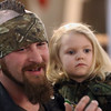 JAY YOUNG | THE GOSHEN NEWS<br /> Jeremy Blue holds his daughter Hailynn, 3, while inspecting motorcycle accessories at the Abate of Indiana's 32nd annual Region One Elkhart County Swap Meet on Sunday morning at the Northern Indiana Event Center in Elkhart.
