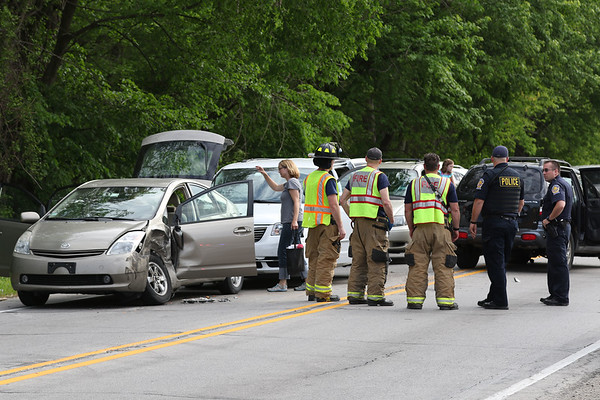 JAY YOUNG | THE GOSHEN NEWS<br /> Goshen police and fire rescue crews work the scene of a three-car accident on Plymouth Ave. in front of Shanklin Park. Traffic backed up on Plymouth as police closed down the road while processing the accident.
