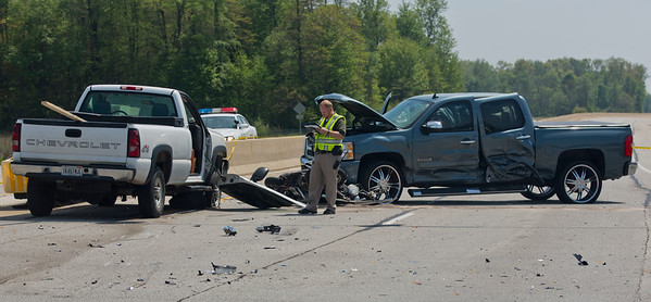 JAY YOUNG | THE GOSHEN NEWS<br /> An officer from the Elkhart County Sheriff Department surveys a fatality accident involving multiple vehicles and a motorcycle Tuesday afternoon at the intersections of C.R. 17 and C.R. 18.