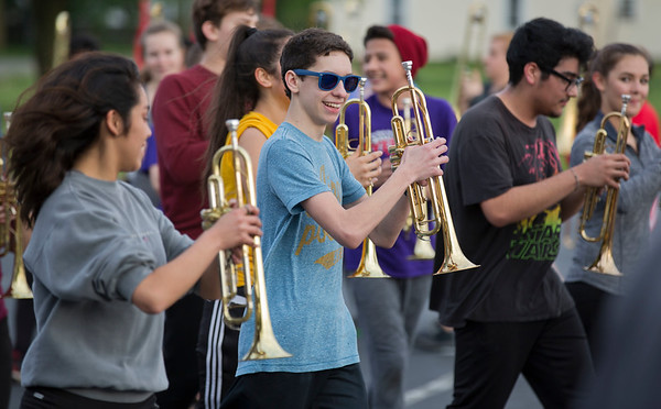 JAY YOUNG | THE GOSHEN NEWS<br /> Goshen High School sophomore Evan Yoder flashes a smile while marching Thursday evening during band practice for their upcoming performance in the Indianapolis 500 parade.