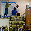 "JAY YOUNG | THE GOSHEN NEWS<br /> Goshen Middle School sixth-grade students, from left, Joshua Carpenter, Logan Lagunas and Tyrell Bowen paint a cycling mural after laying out a square grid on wall inside Chain Reaction Bicycle Project, 510 East Washington Street, Tuesday afternoon. The students, who are part of the New Tech program, involved in a project called The Goshen Renaissance and were painting murals at businesses and organizations around the city. ""The whole project is about connecting to the European Renaissance,"" Jared Leaman, a social students teacher at the school, said. ""We connected it to the European Renaissance to find out what kind of arts and cultural aspects are happening in Goshen right."" Various disciplines are involved in the project. In math, students were learning about topics such as size and scale. Students in English classes wrote proposals to send to the businesses involved. In social studies, students learned all about the European Renaissance and art. About 125 students are involved in the New Tech program. Each of them created an original design for a mural and about 20 were selected to be painted."