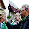 SHEILA SELMAN | THE GOSHEN NEWS<br /> Middlebury walking tour guide Jerry Kindy, forefront, describes the history of the building currently housing the restaurant 41 Degrees North in downtown Middlebury Wednesday. With Kindy are Kim Clarke of Middlebury, left, and Sara Wakefield of Goshen.
