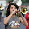 JAY YOUNG | THE GOSHEN NEWS<br /> Goshen High School senior Dianna Campos plays the trumpet with the rest of the GHS band as they practice Thursday evening for their upcoming performance in the Indianapolis 500 parade.
