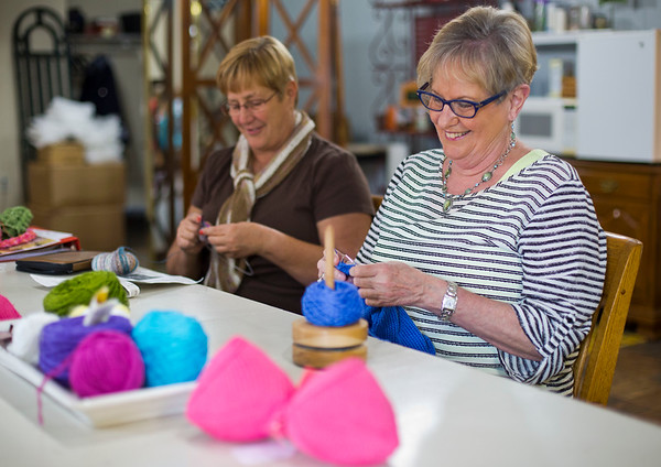 JAY YOUNG | THE GOSHEN NEWS<br /> Linda Altenholf, right, and Jeannine Hartman share a laugh with their knitting group in the back room of Reverie Yarn and Gifts, 201 South Main Street, Tuesday morning.