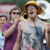 "JAY YOUNG | THE GOSHEN NEWS<br /> Goshen High School junior Trenton Couter snaps his fingers as he sings ""Hey Baby"" with the rest of the GHS band as they practice Thursday evening for their upcoming performance in the Indianapolis 500 parade."