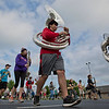 JAY YOUNG | THE GOSHEN NEWS<br /> Goshen High School junior tuba player Andrew Calvillo marches in formation with the rest of the GHS band as they practice Thursday evening for their upcoming performance in the Indianapolis 500 parade.