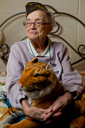 JAY YOUNG | THE GOSHEN NEWS<br /> Ninety-five-year-old World War II veteran Myrtle Huber is the grand marshal for this year's Memorial Day parade. She is pictured in her home at Greencroft Wednesday afternoon holding one of her stuffed tigers. Huber said she has loved tigers since her father took her to a zoo as a child.