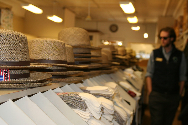 SHEILA SELMAN | THE GOSHEN NEWS<br /> Elkhart County Historical Museum Manager Kelby Rose peruses the hat and sock selection at Gohn Brothers in downtown Middlebury, part of the walking tour.