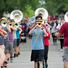 JAY YOUNG | THE GOSHEN NEWS<br /> Goshen High School sophomore Evan Yoder, center, plays the trumpet as he and the rest of the band march during practice Thursday evening  their upcoming performance in the Indianapolis 500 parade.