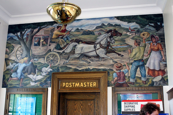 SHEILA SELMAN | THE GOSHEN NEWS<br /> This canvas mural was commissioned by the postal service in 1939. It depicts a stagecoach traveling from Vistula to Middlebury, according to walking tour guide Jerry Kindy.