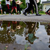JAY YOUNG | THE GOSHEN NEWS<br /> Members of the Goshen High School band are reflected in a puddle of water along East Reynolds Street as they practice Thursday evening  for their upcoming performance in the Indianapolis 500 parade.