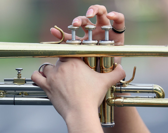 JAY YOUNG | THE GOSHEN NEWS<br /> A member of the Goshen High School band plays the trumpet during practice Thursday evening  for  the band's upcoming performance in the Indianapolis 500 parade.