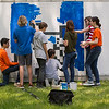 "JAY YOUNG | THE GOSHEN NEWS<br /> Goshen Middle School students paint a mural on a trailer behind Chain Reaction Bicycle Project, 510 East Washington Street, Tuesday afternoon. The students, who are part of the New Tech program, involved in a project called The Goshen Renaissance and were painting murals at businesses and organizations around the city. ""The whole project is about connecting to the European Renaissance,"" Jared Leaman, a social students teacher at the school, said. ""We connected it to the European Renaissance to find out what kind of arts and cultural aspects are happening in Goshen right."" Various disciplines are involved in the project. In math, students were learning about topics such as size and scale. Students in English classes wrote proposals to send to the businesses involved. In social studies, students learned all about the European Renaissance and art. About 125 students are involved in the New Tech program. Each of them created an original design for a mural and about 20 were selected to be painted."