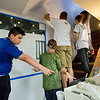 "JAY YOUNG | THE GOSHEN NEWS<br /> Goshen Middle School sixth-grade students Logan Lagunas, left, and Joshua Carpenter check their mural on a computer screen while others  plot out a square grid on wall inside Chain Reaction Bicycle Project, 510 East Washington Street, Tuesday afternoon. The students, who are part of the New Tech program, involved in a project called The Goshen Renaissance and were painting murals at businesses and organizations around the city. ""The whole project is about connecting to the European Renaissance,"" Jared Leaman, a social students teacher at the school, said. ""We connected it to the European Renaissance to find out what kind of arts and cultural aspects are happening in Goshen right."" Various disciplines are involved in the project. In math, students were learning about topics such as size and scale. Students in English classes wrote proposals to send to the businesses involved. In social studies, students learned all about the European Renaissance and art. About 125 students are involved in the New Tech program. Each of them created an original design for a mural and about 20 were selected to be painted."