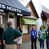 SHEILA SELMAN | THE GOSHEN NEWS<br /> Middlebury walking tour guide Jerry Kindy, right, leads a group around downtown Middlebury in a sample tour before the kickoff Wednesday.