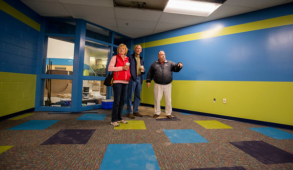 JAY YOUNG   THE GOSHEN NEWS<br /> Kevin Deary, right, executive director of the Boys and Girls Club takes Mark and Kathy Mow on a tour of the club that is currently under renovations.