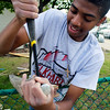 Roger Schneider | The Goshen News<br /> Pierre Archie of Elkhart works to pull screws from a board at the Arbor Ridge Apartments Campus Center for Young Children during Help-A-House Saturday.