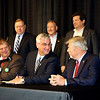 SHEILA SELMAN | THE GOSHEN NEWS<br /> Indiana Gov. Eric Holcomb, center, grins at  Rep. Bob Cherry, R-Greenfield, while signing one of two bills concerning the RV industry Thursday morning at the RV Power Breakfast. At left is State Sen. Blake Doriot, R-Syracuse. Standing, from left, are State Senator Joe Zakas, R-Granger, IMHA-RVIC President Glen James (Barrington Management), IMHA-RVIC Past President Ken Eckstein (Mount Comfort RV), and State Rep. Wes Culver, R-Goshen.