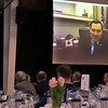 SHEILA SELMAN | THE GOSHEN NEWS<br /> U.S. Sen. Joe Donnelly appears onscreen from his Washington D.C. office for a live teleconference with RV leader at the fifth annual RV Power Breakfast Thursday morning. Asking Donnelly question is  RVIA Public Relations Committee Chairman B.J. Thompson, left at podium.