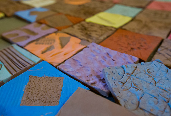 JAY YOUNG | THE GOSHEN NEWS<br /> Tiles created by participates in the Spring Break Arts Camp hosted by Goshen Youth Arts.