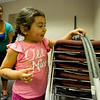 JAY YOUNG | THE GOSHEN NEWS<br /> Four-year-old Ashlynn Rodriguez, of Goshen, smiles with anticipation as she releases a marble down the track of her rollercoaster during Family Science Night at the Goshen Public Library Thursday evening. On the second Thursday of each month, the library hosts a S.T.E.A.M. inspired Family Science Night with the goal of teaching children basic science topics while having fun. This month's topic was physics. Participants learned about potential energy, kinetic energy and momentum by building marble rollercoasters out of pipe insulation and masking tape.