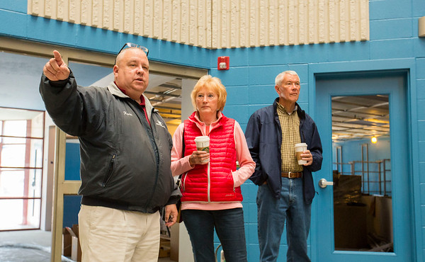 JAY YOUNG | THE GOSHEN NEWS<br /> Kevin Deary, left, executive director of the Boys and Girls Club takes Mark and Kathy Mow on a tour of the club that is currently under renevations.