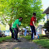 Roger Schneider | The Goshen News<br /> Dori Hartzler, left, and Simmon Hertzler Gascho, work to clean weeds from a sidewalk at 411 Summit St., Goshen Saturday. The two were among hundreds of volunteers who turned out for the annual Help-A-House Community Work Day.