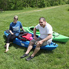 Roger Schneider | The Goshen News<br /> Sherry Cisneros and Tony Ortiz rest with their kayaks Saturday after they asked firefighters to help them free one of the boats from a logjam at the Baintertown County Park.