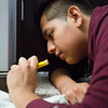 JAY YOUNG | THE GOSHEN NEWS<br /> Goshen High junior Diego Torrejon uses a paint pen to touch up floor trim during his Building Trades class Wednesday afternoon. The class is working on a home at 1530 Sandpiper Lane in Goshen.