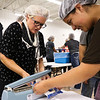 LEANDRA BEABOUT | THE GOSHEN NEWS<br /> Shari Tarnow and Andrea Mendoza work together to assemble meals for Feed My Starving Children.