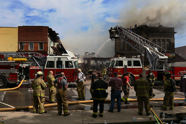 JAY YOUNG   THE GOSHEN NEWS<br /> Firefighters work to bring a large fire under control in downtown LaGrange Tuesday afternoon.