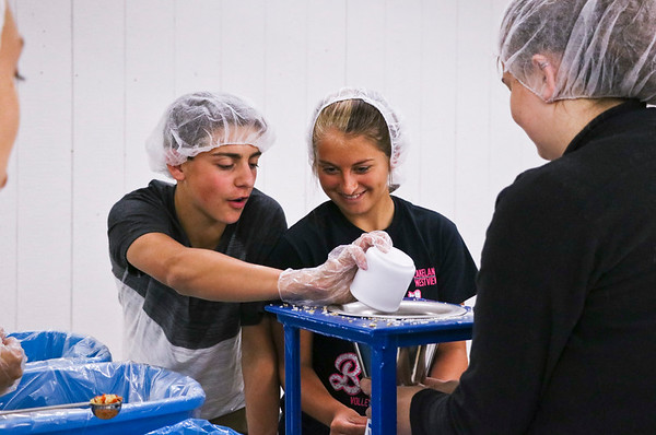 LEANDRA BEABOUT   THE GOSHEN NEWS<br /> Clinton Bowers and Hailey Alleshouse measure food for Feed My Starving Children.
