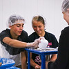 LEANDRA BEABOUT | THE GOSHEN NEWS<br /> Clinton Bowers and Hailey Alleshouse measure food for Feed My Starving Children.