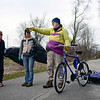 BEN MIKESELL | THE GOSHEN NEWS<br /> Tyler Klassen, shop manager at Chain Reaction Bicycle Project, directs Andrea Milne, center, and Pam Rothi, left, while cleaning up the Pumpkinvine Trail Thursday near Abshire Park.