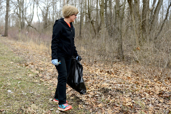 "BEN MIKESELL | THE GOSHEN NEWS<br /> Pam Rothi of Bristol looks for trash along the Pumpkinvine Trail Thursday as part of an clean up effort organized by Chain Reaction Bicycle Project in Goshen. ""I use the trail a lot, so I want to do my part in cleaning it up,"" Rothi said."