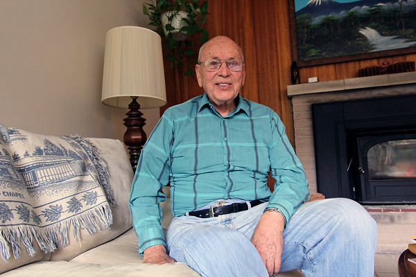 GEOFF LESAR | THE GOSHEN NEWS<br /> <br /> Former Goshen College President Vic Stoltzfus sits inside his Goshen home Tuesday afternoon. Stoltzfus participated in the third of three 1965 marches in Selma, Alabama, participating in non-violent protest alongside the likes of the Rev. Dr. Martin Luther King Jr. and other civil rights activisits.